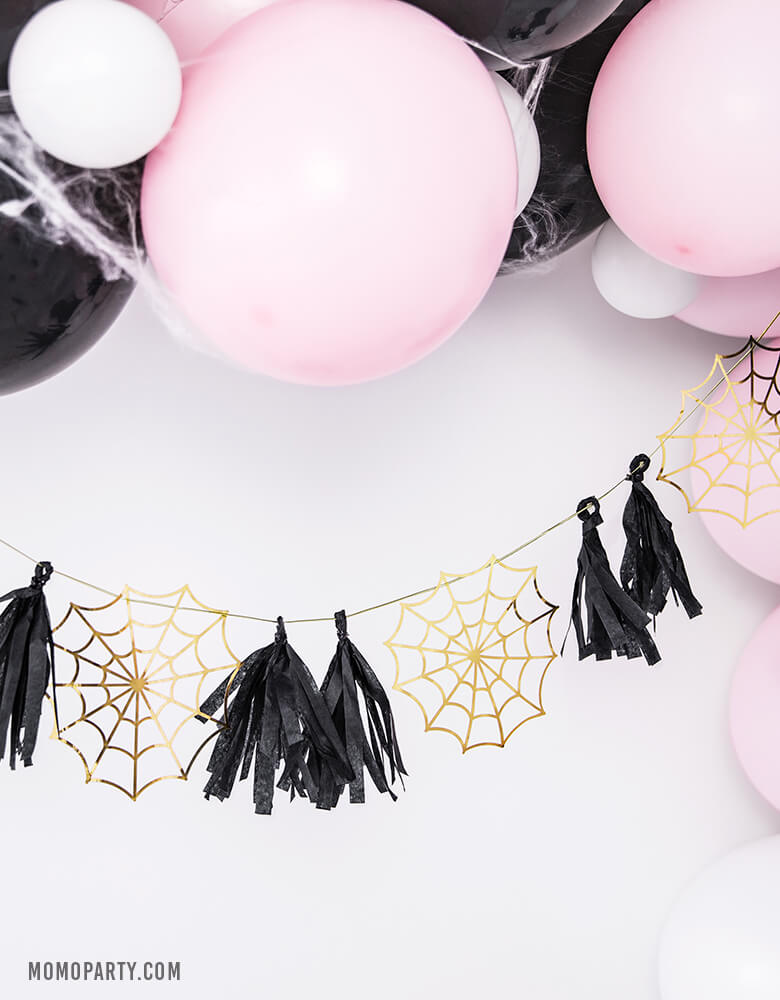 Pastel Pink halloween party decoration with Pastel pink and black balloon garland, Party Deco Halloween Spider web Paper Garland of boo-tiful gold spiderwebs and black tassels. for halloween home decoration, Kids modern spooky halloween party, hocus pocus party trick-or-treating party, nightmare before christmas party, witch themed party and all halloween related celebrations