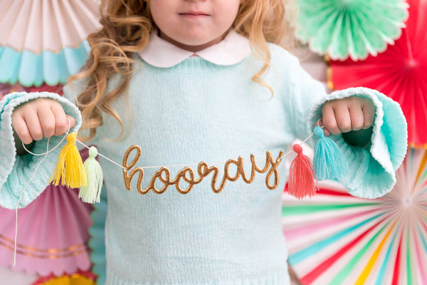 little girl holding MyMindsEye_Hip Hip Hooray Banner Garland