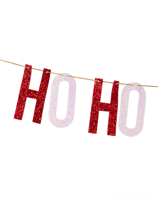 close up details of  Studio Pep, Ho-Ho-Ho Artisan Banner. This hand-pressed artisan banners is cut from high quality, glitter fabric and includes thick glitter cord