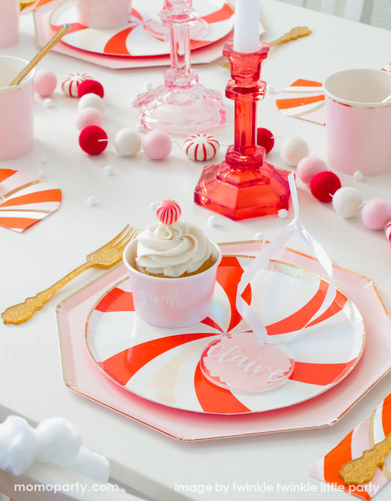 A Christmas Party Tablescape idea with Peppermint Plate Layerd with Dusty Pink Plates, along with candy cane napkins