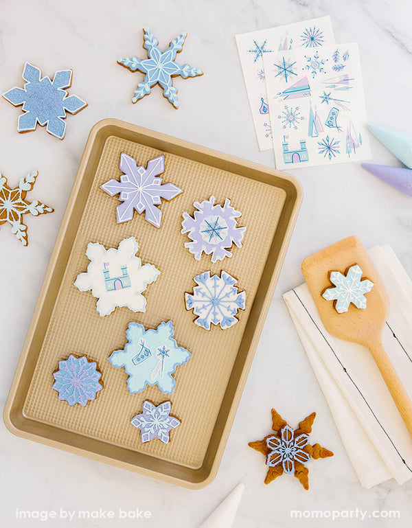 pretty snowflake shaped cookies on a baking tray decorated with Make Bake shop - Ice Princess Edible Decorating Stickers, Artwork by Hello!Lucky for Make Bake. Its ready for your little one's Frozen birthday party,  winter wonderland themed party, Let it snow party