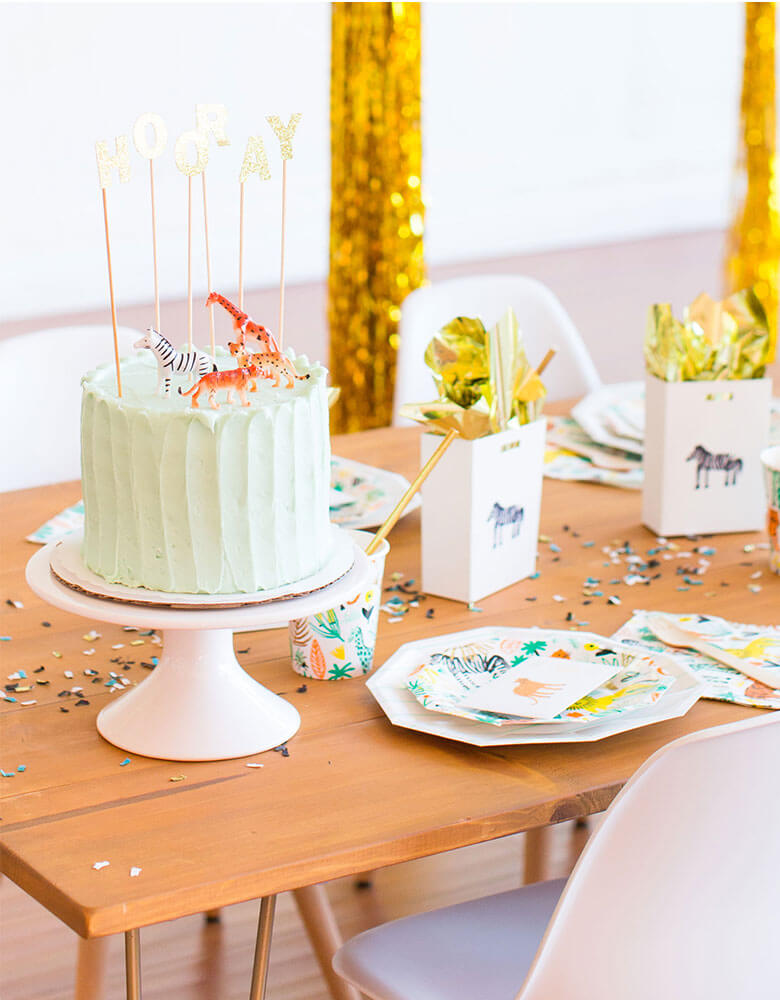 Kid's Safari themed birthday party featuring Daydream Society Into The Wild Collection and Temporary Tattoos