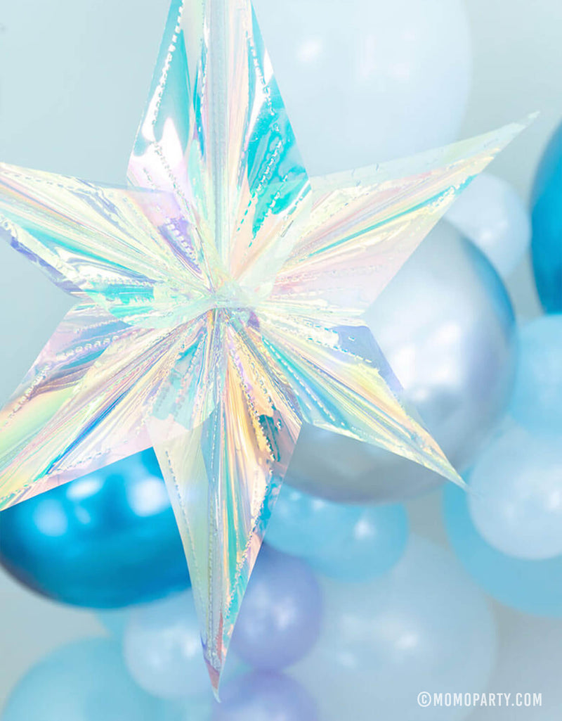 "16"" Iridescent Star hanging Decoration in front of a beautiful balloon garland with blue, purple and silver color combos for a girls Frozen themed party"