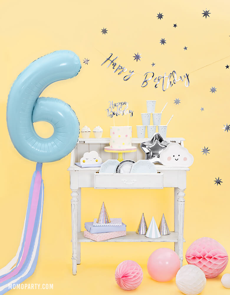 "Party Deco - 34 inch - Large Number 6 Pastel Blue Foil Mylar Balloon with pastel blue and pink tissue strings floating on the side of table with cloud shape plates, silver star plates and cake with silver ""happy birthday"" sign cake topper for a 6 years old birthday"