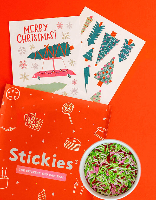 Make Bake shop - Let's Get A Tree! Cakescape Edible Stickers, include 2 sheets/25 large format Stickies of many christmas trees and snowflake and christmas tree truck designs by Hello!Lucky, matching Confetti Crunch™ sprinkles with green, red, pink and white colors. 100% edible and super kid-friendly,  Vanilla-flavored. Simply peel it and apply to iced cakes, cupcakes, cookies, These easy baking hacks cakescape edible stickers will make decorating holiday cakes so much easier!