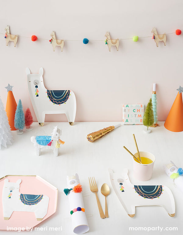 Modern cute llama party with Meri Meri llama with pom pom garland, llama plates and napkins, mini Llama Pinata and Pale pink Dinner plates and lots of colorful trees