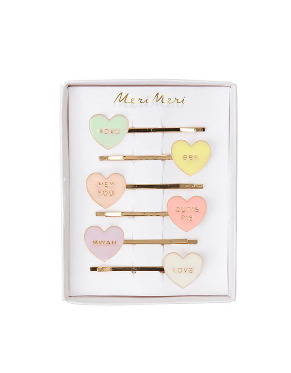Meri Meri Love Hearts Enamel Hair Slides Set of 5 in 5 pastel colors with conversation heart texts on them for Valentine's Day party