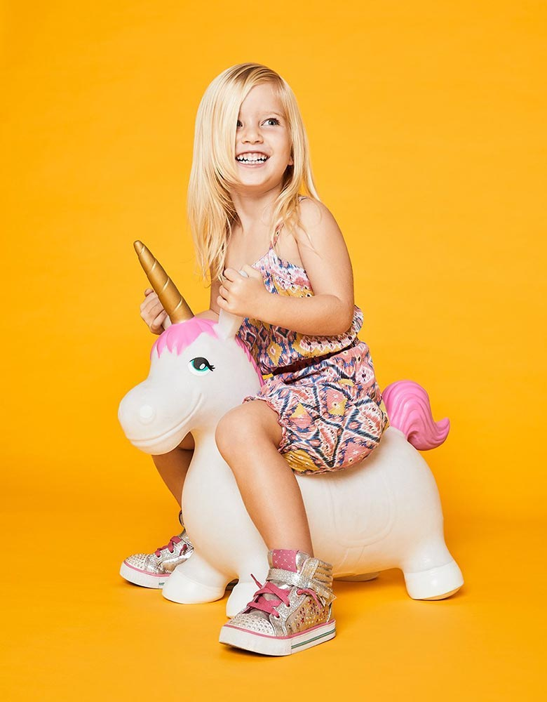 kid sit and play with sunnylife unicorn hopper