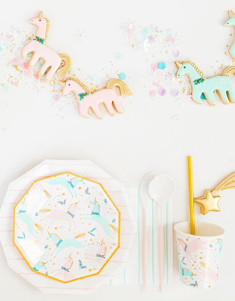 Daydream Society Magical Christmas Tableware featuring unicorn illustrations in pastel colors for a Holiday dinner party decorated with matching sugar cookies