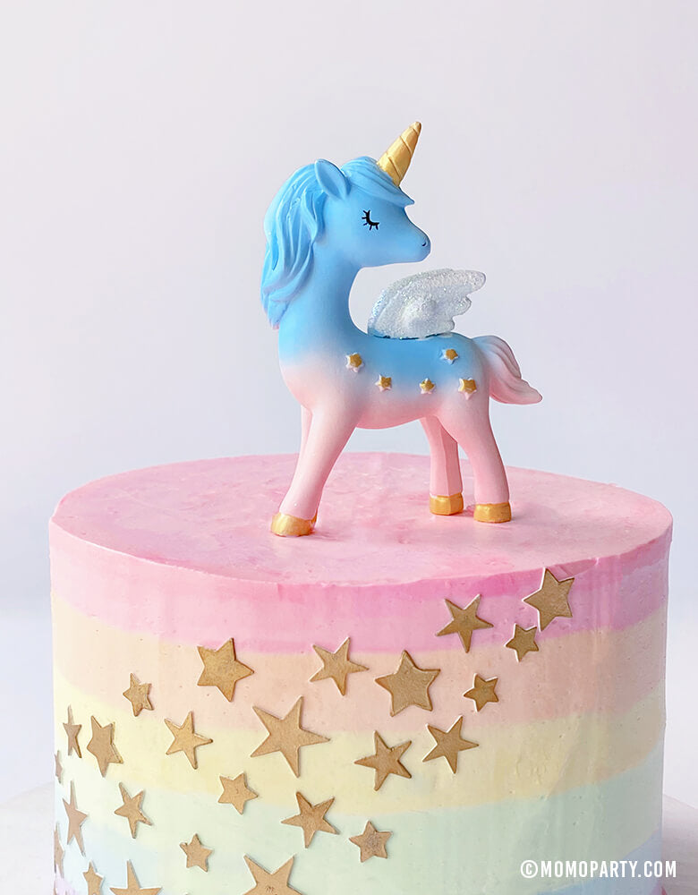 Magical Unicorn Cake Topper,  4 inch tall, with blue and pink color, gold horn and gold stars on the body on a pastel rainbow star cake. Unicorn toys, Unicorn display toy for a Unicorn lover and rainbow birthday party, unicorn birthday party