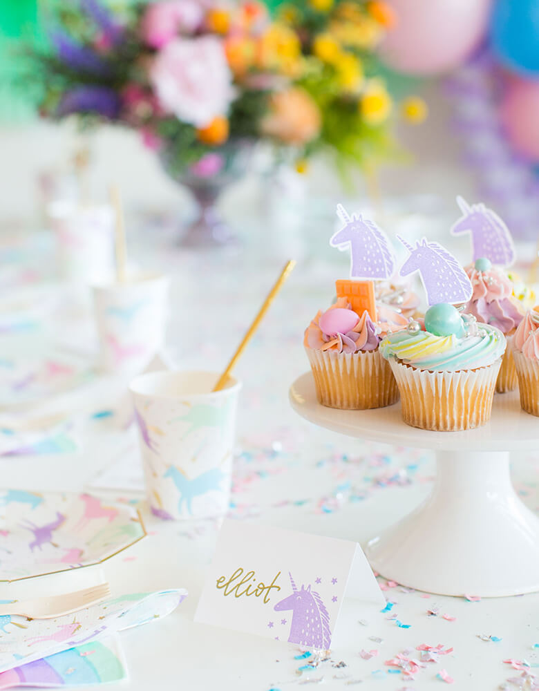 Magical Unicorn party table of rainbow color cupcakes with Unicorn cupcake topper and and table sign, made of Day Dream Society Magical Unicorn Rubber Stamp
