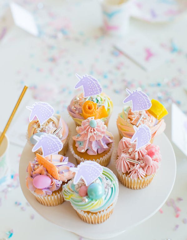 Magical Unicorn party table of rainbow color cupcakes with Unicorn cupcake topper made by Day Dream Society Magical Unicorn Rubber Stamp