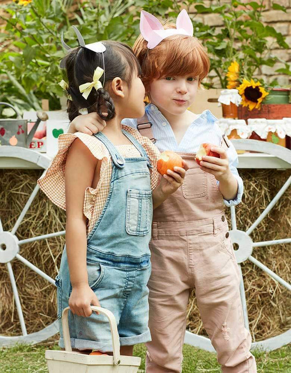 Kids in a farm themed party with Meri Meri's On The Farm Animal Ears of a pig and cow