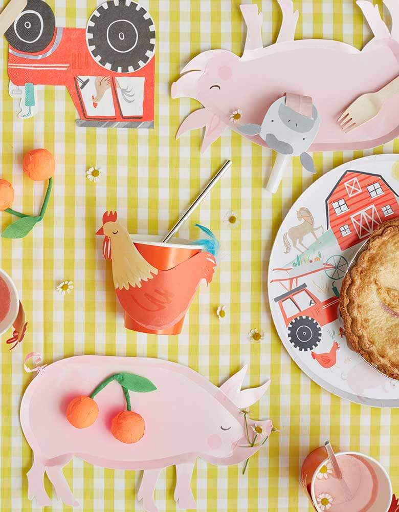 Meri-Meri-On-the-Farm-Collection_featuring farm themed party plates cups and napkins on a yellow gingham tablecloth