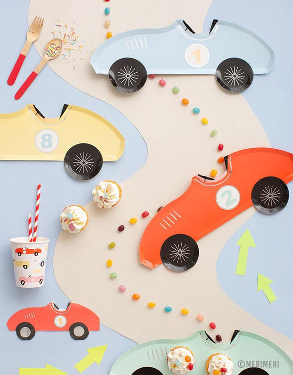 A car themed party table with Meri Meri's Vintage Race Car Tableware Collection including car shaped plates, napkins and car illustrated cups