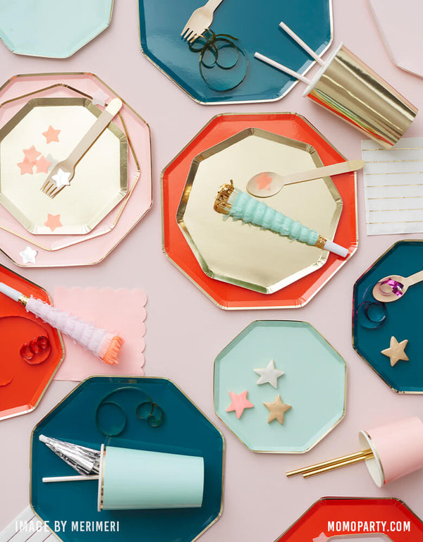 Meri Meri Holiday Table Partyware with Gold side plate, with Red Dinner plate, Gold Cocktail plate stack with Dusky Pink side plate on top of Dusky Pink Dinner Plate, Dark Teal Dinner plates, with Mint Highball Cup, Gold Highball Cup, Iridescent Party straws, start shaped cookies, These high-quality paper with a stylish shiny gold details modern partyware are perfect for all kinds of celebration, even, birthday party, baby shower, wedding and celebration for all occasion.