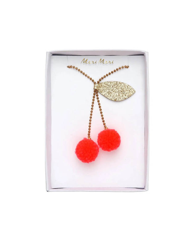 Meri Meri Cherry Pom Pom Necklace with clear box package. Featuring Yarn pompoms with gold glitter fabric on a Gold enamel bead chain. This beautifully crafted cherry pompom necklace is simply charming. Perfect as a gift for someone who loves quirky accessories.