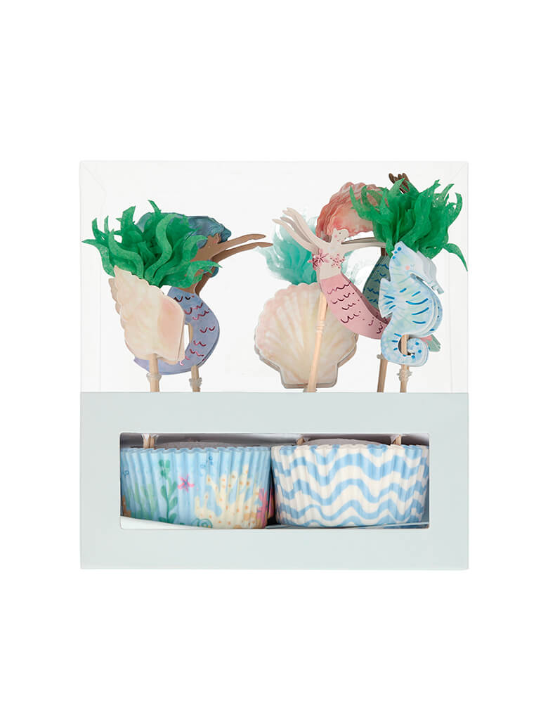Meri Meri Mermaid Cupcake Kit. Pack of 24 cases in 2 designs, 24 toppers in 6 designs .It includes 24 toppers, with 6 designs including beautiful mermaids, a seahorse and seaweed. The 24 cupcake cases feature 2 charming coordinating designs. The kit is presented in a special box, which makes a delightful gift.