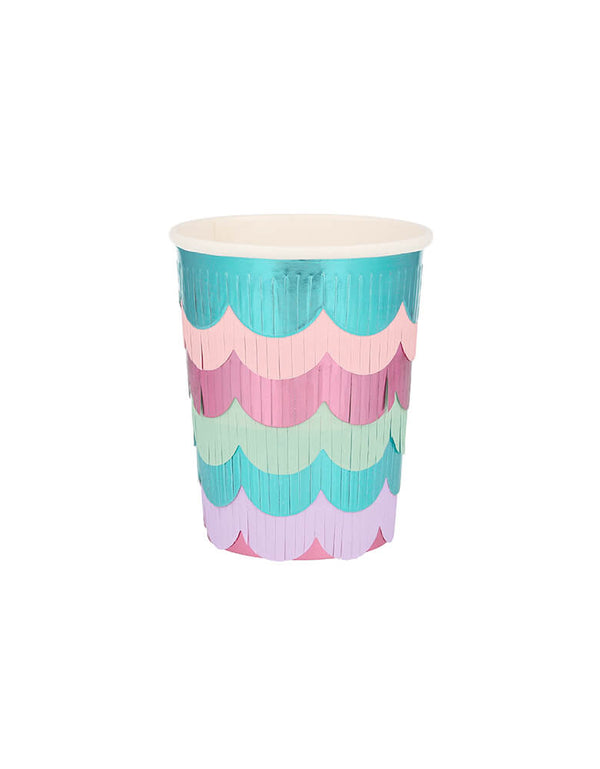 Meri Meri Mermaid Scalloped Fringe Cups.  These cups designed to look like a mermaid's glittering tail, featuring 6 strips of scalloped foil fringe layered to create a sensational effect. They are crafted with a solid pink base with 6 strips of scalloped foil fringe layered on top. The layers are in delightful blues and pinks. They are simply perfect for a mermaid or under-the-sea party.