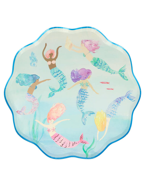 Meri Meri Mermaid Swimming Plates. Pack of 8. 10.5 x 10.5 inches. These high quality paper plates featuring 6 beautiful mermaids swimming in the sea, with lots of color and shimmering foil detail, and pink and blue foil detail for a stylish touch, They are crafted in a sensational shell-shaped design. These gorgeous shell-shaped plates will look amazing at a mermaid party or under-the-sea party.