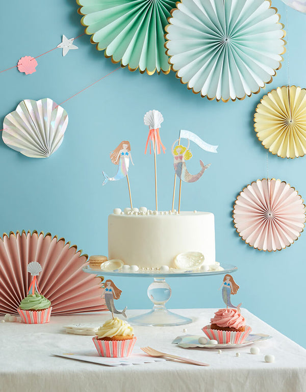 Mermaid party set up of Let's Be Mermaids Cake Topper on white cake