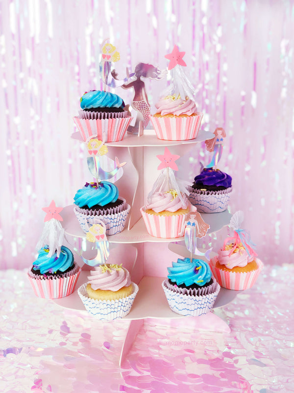 cupcake with Mermaid cupcake  iridescent toppers on pink cake stand