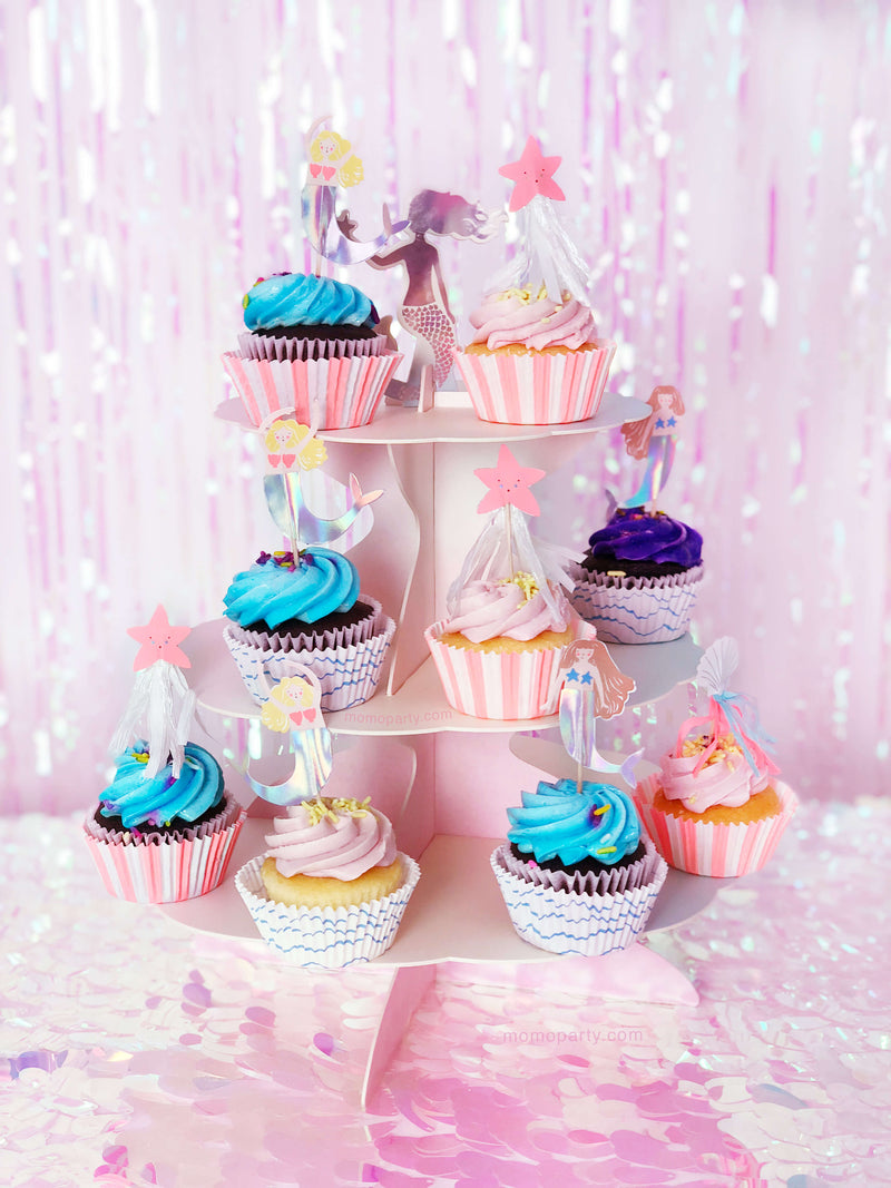 cupcakes with Mermaid themed toppers on the pink cake stand