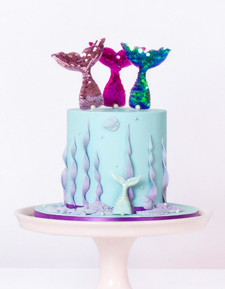 Reversible sequin fabric mermaid tail toppers with a baby blue Mermaid cake