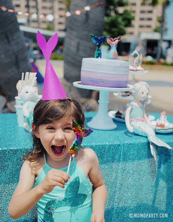 Happy Girl wearing Mermaid Tail Party Hat at Beach Mermaid Party