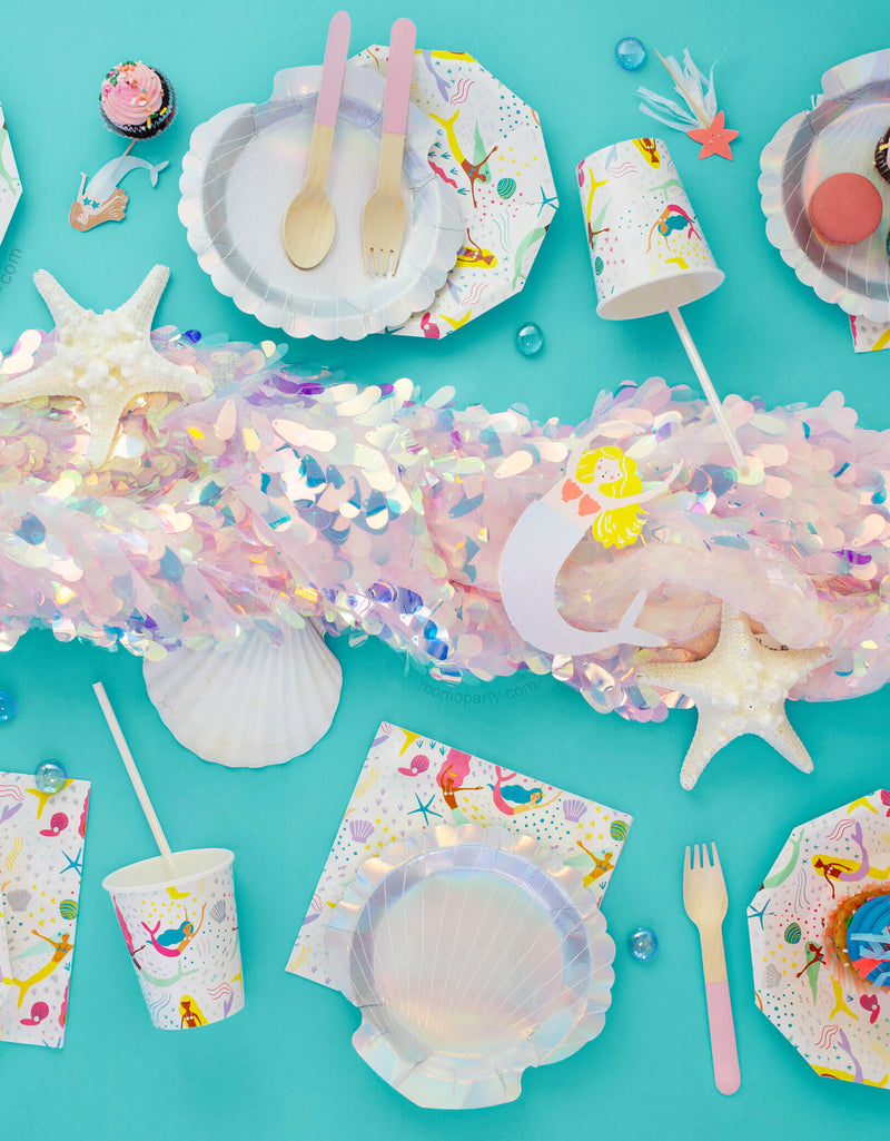 Mermaid Party Table set up inspiring with Small Shell holographic Plates, Mermaid cups, napkins, pink wooden utinsils
