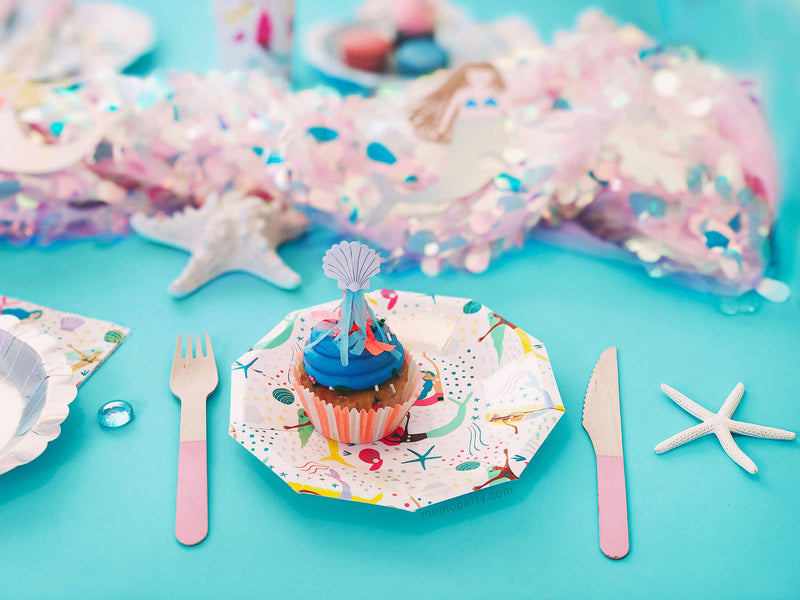 Mermaid themed party Table Set up close up look with cupcake on mermaid plates with pink wooden curlery