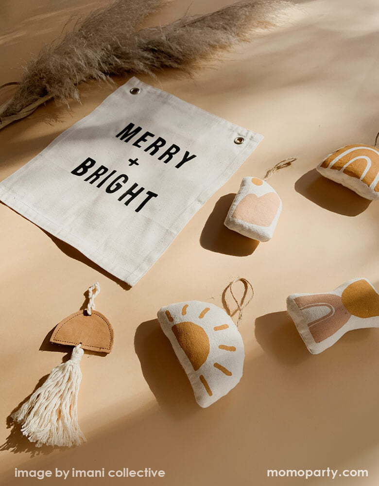 Modern holiday decoration inspiration items of Imani Collective MERRY + BRIGHT BANNER, Natural color Handmade ornament made with natural cotton + genuine leather, Natural Dried Reed Pampas Grass. These modern holiday decorations were sewn and screen printed by hand on natural canvas. These are perfect Holiday decoration for your entrance hall or your little one's playroom! Sold by Momo party store provided modern party supplies, boutique party supplies, chic and high end holiday supplies