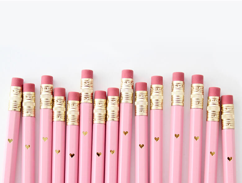 close up details of Inklings Paperie Pink Mini Pencils with Mini Gold Heart. This set of 12 sweet mini pencils comes foil-imprinted with a tiny gold heart. With a gold ferrule and classic pink eraser, pencils come pre-sharpened and are perfect for party games or favors.
