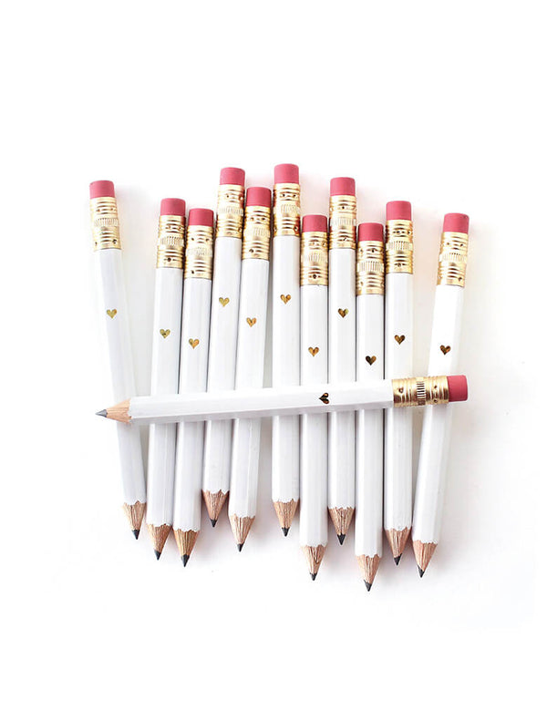 inklings Paperie, white Mini Pencils with Mini Gold Heart. Set of 12,This set of 12 sweet mini pencils comes foil-imprinted with a tiny gold heart. With a gold ferrule and classic pink eraser, pencils come pre-sharpened and are perfect for party games or favors.