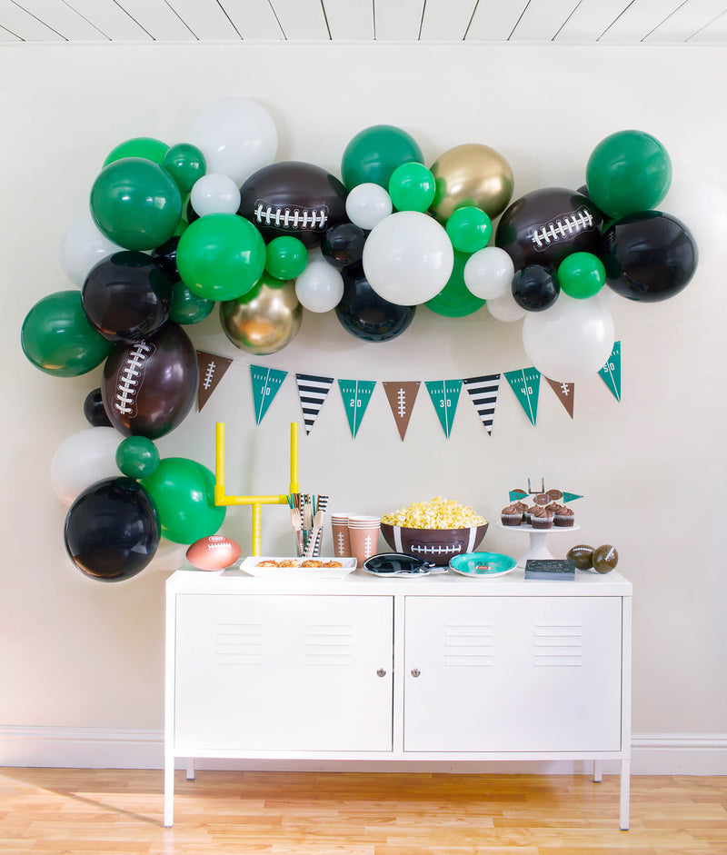 Momo Party Football themed Birthday Party Set up inspiration with football shaped latex balloon garland, eco-friendly football themed partywares, ideas for kids football birthday party, super bowl celebration
