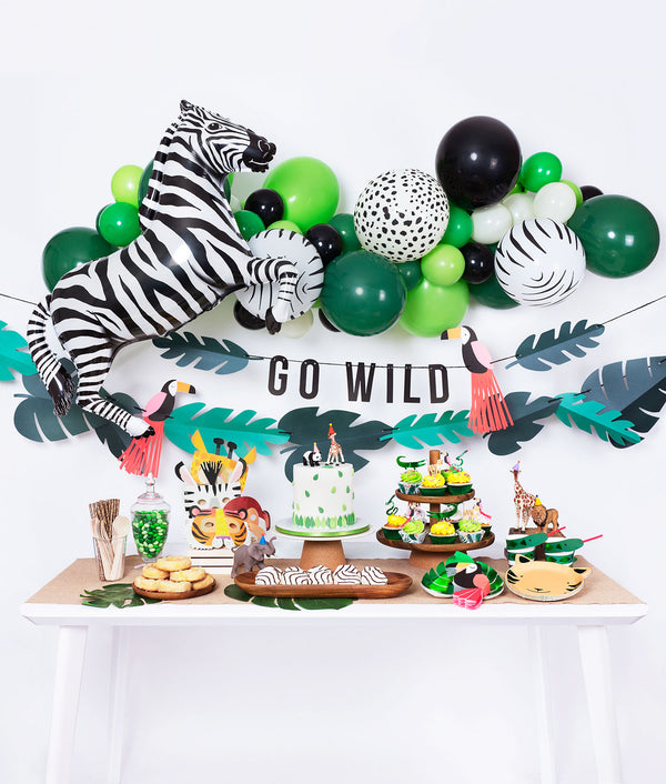 kids jungle themed birthday party inspiration table and decoration set up
