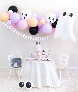 Momo Party 2020 Halloween Boo To You Party Look with: Halloween Ghost Mylar Balloon, Pastel pink and purple balloon garland, Boo To You Ghost Banner as wall decoration, Table set up with Lilac Dinner Plates and Tumbler Cups,  Iridescent Ghost Plates, Holographic Ghost Napkins, pink cake with Boo letterboard cake topper, 2 Friendly Eyeball latex Balloons as an eye, Inspire ideas for you Kids Halloween Party, Pink Halloween, Not too Spooky birthday party, Hocus Pocus party, spooktacular halloween party