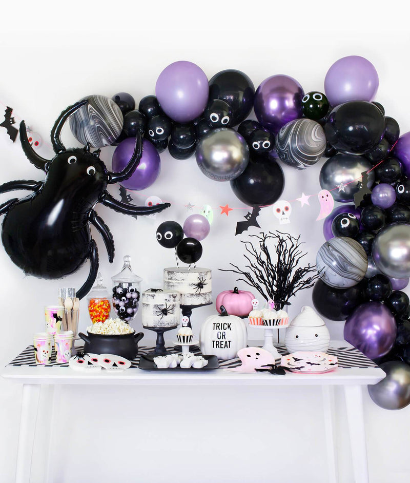 Momo Party Halloween party collection table set up with black, purple chrome and silver color balloon garland, black spider foil balloon decoration