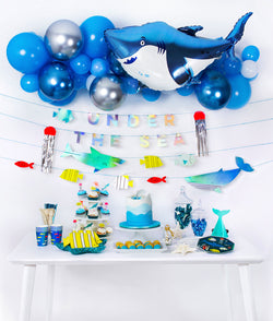 boy's under the sea shark themed birthday party idea and set up