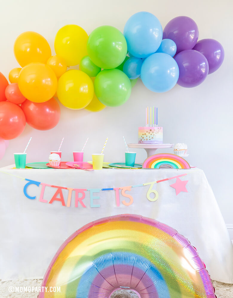 Rainbow theme Modern birthday Party, Momo party in a box included Oh happy Day Large Rainbow Plate Set, Oh happy day Rainbow Plates, Rainbow Cup Set, My minds Eye's Hip Hip Hooray Fringe Small Napkins, Hyper Tropical Wooden Cutlery Set, Mixed Pastel Striped Straws, Holographic Pastel Glitter Rainbow Foil Balloon, Mixed Rainbow colored Balloon Garland, for a girl's 6 years old Rainbow themed birthday party, Pride Party