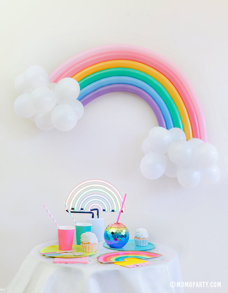 Modern Pastel Rainbow Party At home Look with Rainbow Balloon Animal with Rainbow color Qualatex twisting balloons and 5 inch white latex balloons as cloud for wall decoration, A Sunnylife Rainbow neon light, Oh Happy Day Rainbow shape plates, Rainbow Large Plates Set, Rainbow paper cups, Blush Rainbow Ombre Disco Ball Tumbler, Hip Hip Hooray Fringe Small Napkins, Cupcakes for rainbow vibe celebration, party decoration, Rainbow birthday party, Summer party, Modern party celebration.