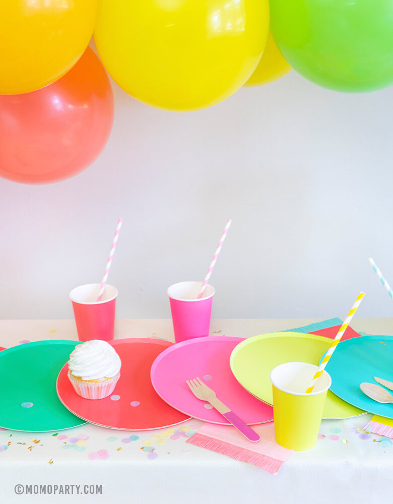 Rainbow Party Dessert table with Oh happy day colorful Rainbow Large Plate Set, Rainbow Cup Set, cupcakes, Hyper Tropical Wooden Cutlery Set, Hip Hip Hooray Fringe Small Napkins for a modern rainbow themed birthday party, pride party, unicorn party