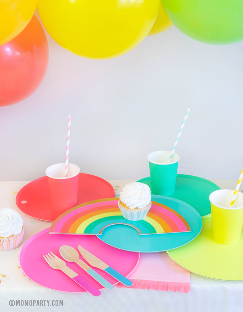 Modern Rainbow Party Dessert table look with Oh happy day Rainbow Plates, colorful Rainbow Large Plate Set, Rainbow Cup Set, cupcakes, Hyper Tropical Wooden Cutlery Set, colorful ballon garland for rainbow themed birthday party, pride party, unicorn party