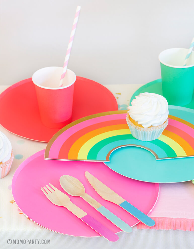 Modern Rainbow Party Dessert table with Oh happy day Rainbow Plates, colorful Rainbow Large Plate Set, Rainbow Cup Set, cupcakes, Hyper Tropical Wooden Cutlery Set, Hip Hip Hooray Fringe Small Napkins for rainbow themed birthday party, pride party, unicorn party