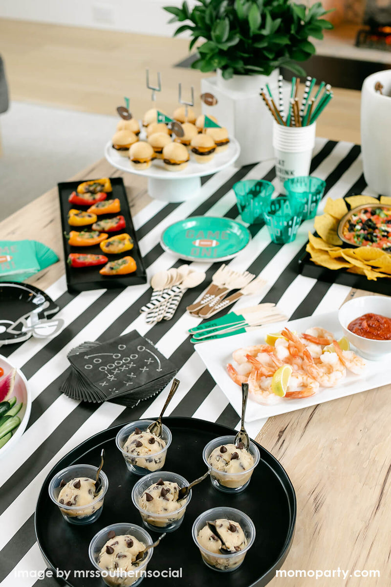 Football Party inspo, using cakewalk true brands Green Game on Football Party Paper Plates, Black Game Play Napkins, Football Tailgate Helmet Appetizer Plates, Tailgate Treat Picks on mini burgers on the cake stands, Football Tailgate Wooden Cutlery Set, Football Tailgate Party Straws inside of Eat Drink Football Paper Cups, small bites, all on the Hester & Cook simple striped runner. These modern table styling are perfect for super bowl party and entertaining with family and kids