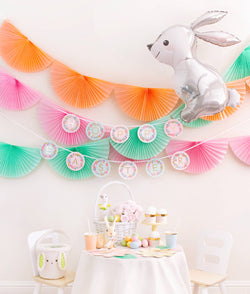 Momo Party Easter Party celebration box with Bunting Fan Garlands, Rifle Paper Garden Party Letter Garland, Woodland Bunny Foil Mylar Balloon as decoration, and Pastel Daisy Large Plates, Pastel Cups, Leaf Napkins and Easter Basket for dessert table