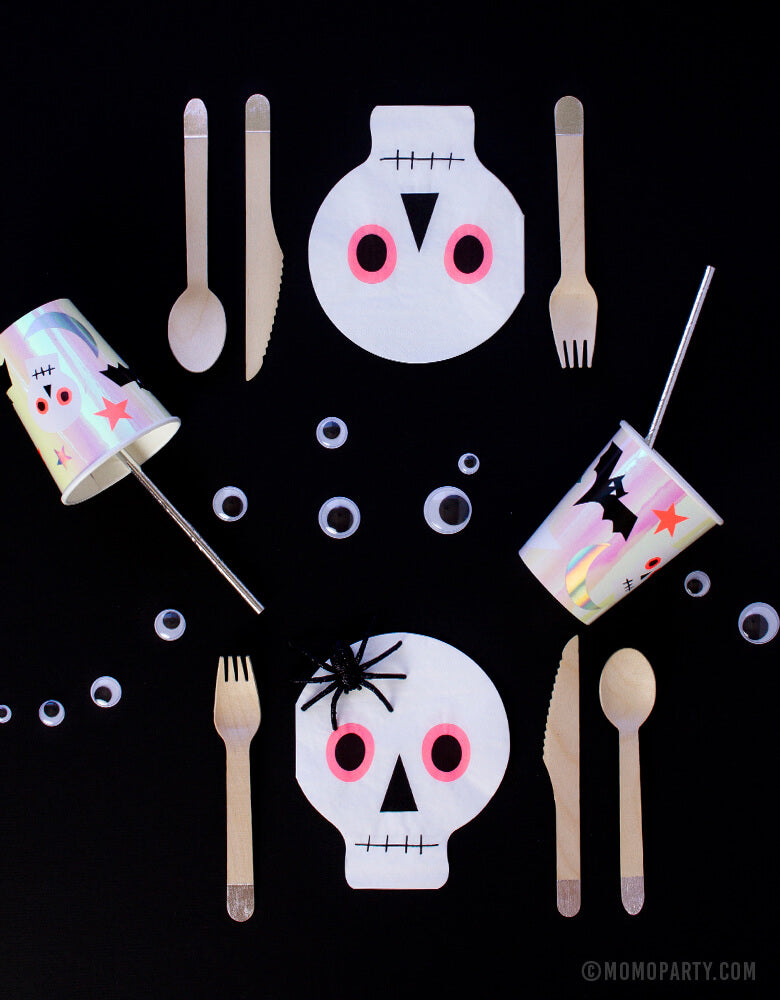 Momo Party Kids Halloween Party tableware of Meri Meri_Neon-Skull-Napkins with eco-friendly silver wooden utensils, halloween icon cups, silver straws, goggle eyes, and spider as decorations