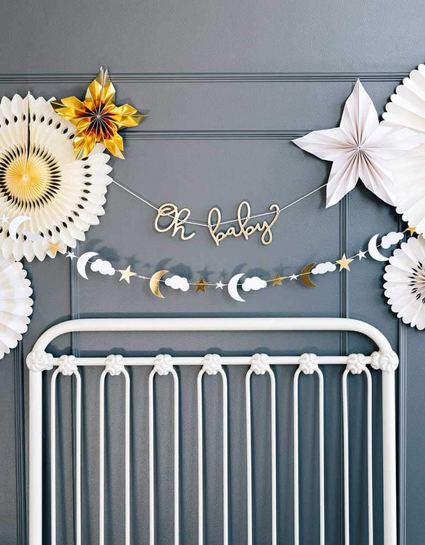 Baby nursery decoration ideas featuring my mind's eye oh baby banner set and baby pink fans on the wall