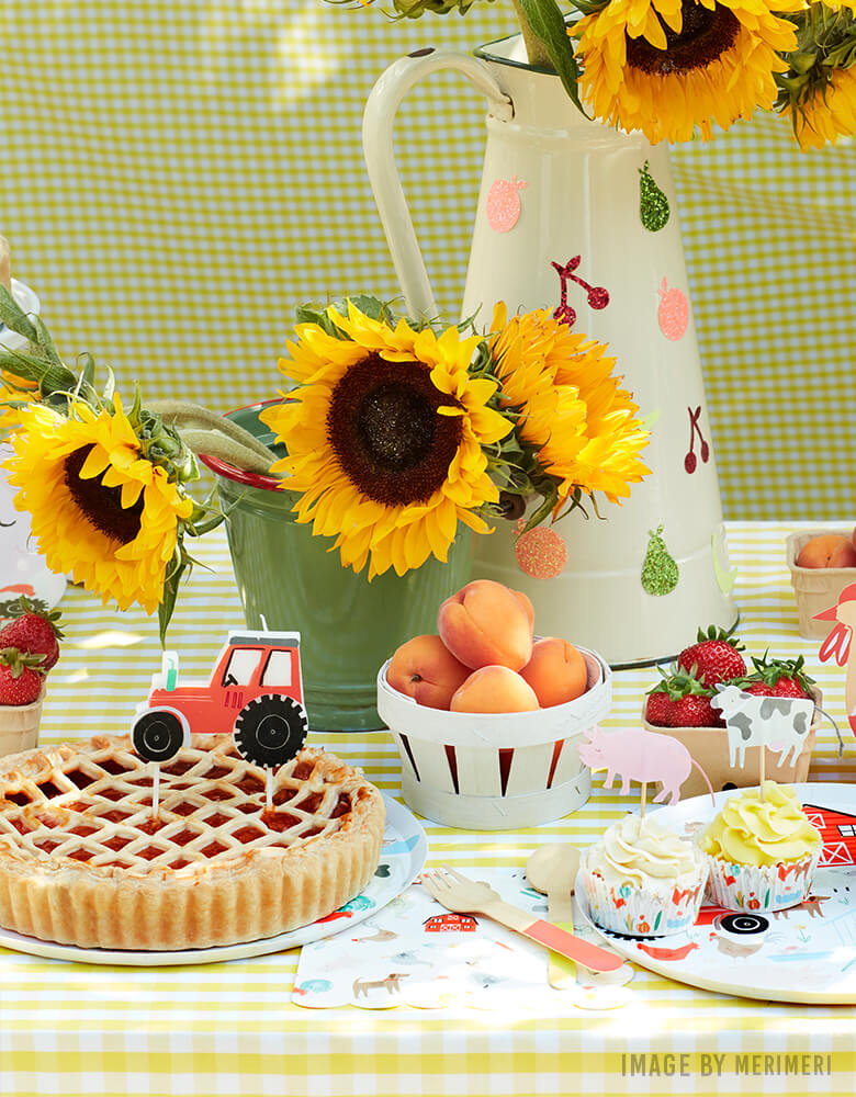 Farm themed party with  Apple Pie with On the Farm Tractor Candle, animal cupcake kit, sunflowers on the dessert table