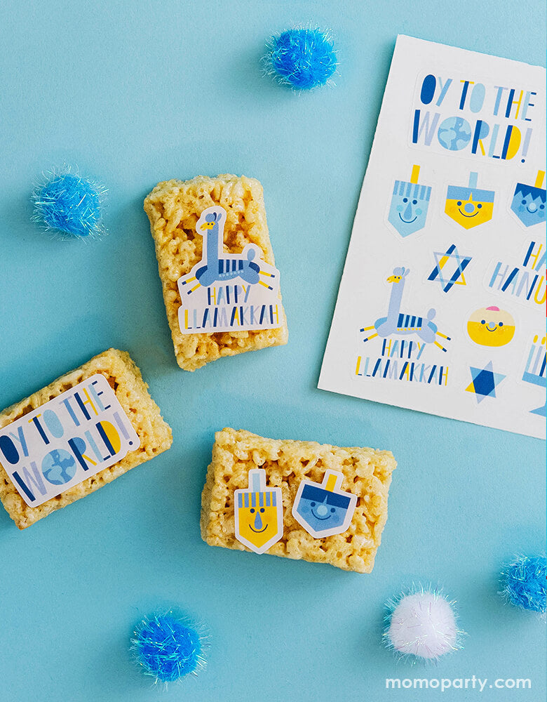 Rice cake treats decorated with Make Bake shop Oy To The World Edible Decorating Stickers, include edible stickers with many cute Hanukkah symbols illustration like Jews light candles, Menorah, dreidels, Gold Coins. Simply peel it and apply to iced cakes, cupcakes, cookies, These easy baking hacks will be make decorating baked goods so much easier to this Hanukkah